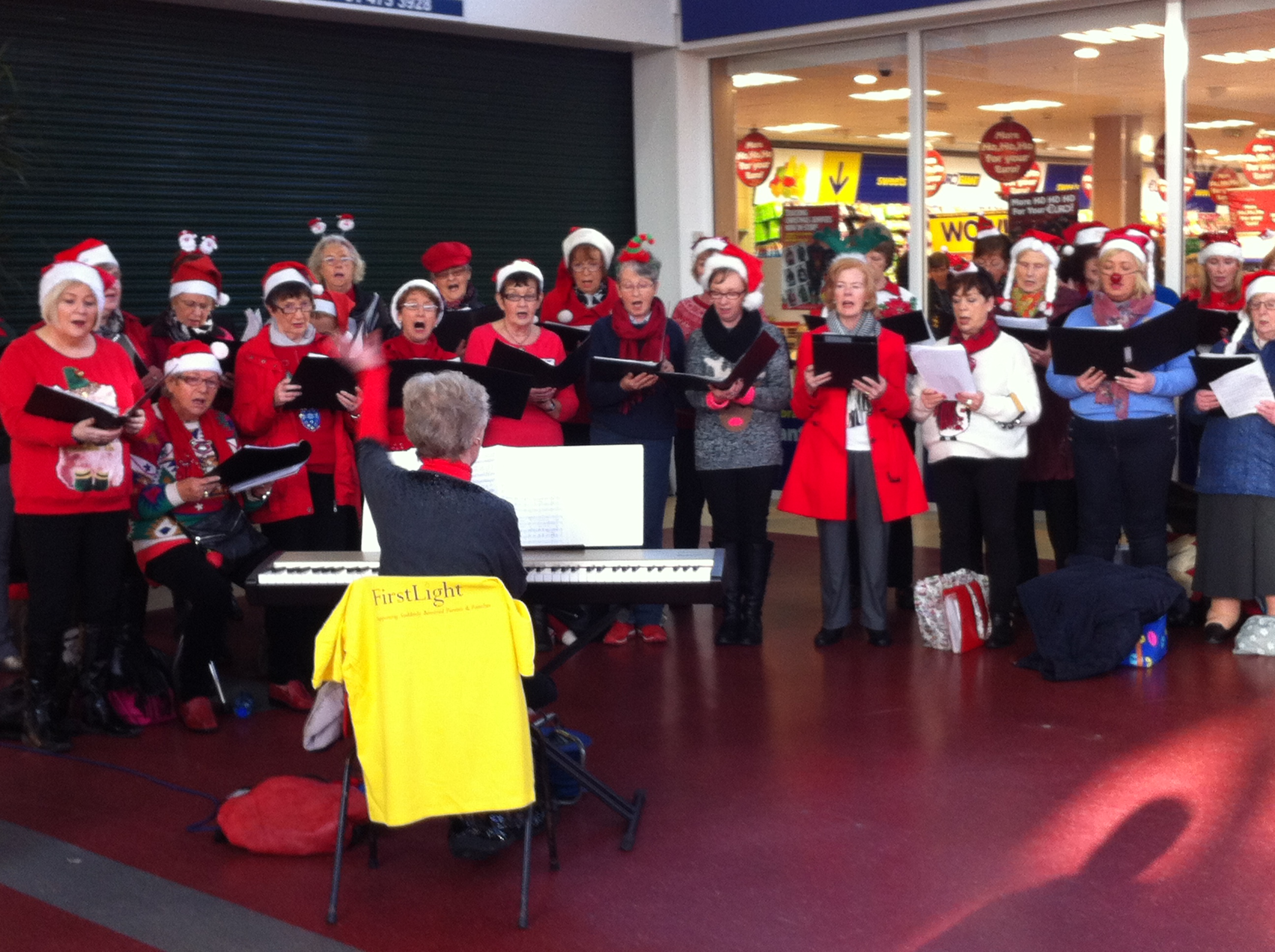 Choir members carol singing for First Light in December 2014 (2)